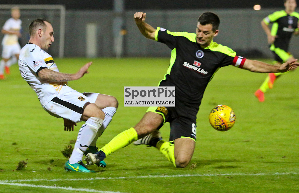 Steven Bell with a high tackle on Mark Stewart during the Dumbarton v Stranraer Irn Bru Cup round three 06 October 2017<br /> <br /> <br /> <br /> <br /> <br /> (c) Andy Scott | SportPix.org.uk