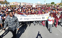 CAPE TOWN, SOUTH AFRICA - Wednesday 17 July 2013, as part of Mandela Day learners from Sivile Primary School in Khayelitsha, an impoverished suburb of Cape Town, did a pedestrian walk to highlight the Red Cross War Memorial Children's Hospital's Childsafe campaign. Every year, approximately 1.3 million people are killed on the world&rsquo;s roads. Road crashes are the number one cause of death for children and young people. Worldwide, road deaths are overtaking the number of deaths from TB and malaria, and it has been projected that within 20 years, more people will die on the roads than of HIV/AIDS. As part of the Decade of Action for Road Safety 2011-2020 and in support of the Mandela&rsquo;s family initiative titled &ldquo;Long Short Walk&rdquo;, Childsafe South Africa has organized a walk Sivile Primary School . As this years&rsquo; main theme (Global Road Safety Week in May) was focused on pedestrian safety the main aim was to raise awareness on issues pertaining to pedestrian safety. Therefore, Childsafe South Africa&rsquo;s three main objectives need to achieve the main aim, through the Long Short Walk are:<br /> To raise road safety awareness for all pedestrians.<br /> To encourage individuals and groups to participate in walks using safety materials and banners.<br /> To contribute to the Sustainable Development Goal on safe walking for all.<br /> Photo by Roger Sedres/ImageSA.net