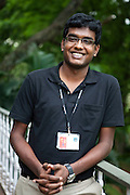 """Akilan Vijayarangam ..22 year old Akilan Vijayarangam is from Chennai. He works under the first level support team and MOC (Management Operational Centre) wherein his work involves monitoring engineering screen and assigning tickets to relevant groups. Akilan works an average of 9 hours a day and plays badminton and Table Tennis with his bosses during spare time. He also represents his office Table Tennis team for various competitions.  """"I am lucky I get to play with the big bosses, I get to have personal interaction with them - and they constantly encourage me not only for my professional development but also on the sports front,"""" says Akilan. """"They are very simple people, and do not have a concept of hierarchy"""" he laughingly adds...Akilan couldn't afford to pay his engineering college fees while he was studying Computer Science, but managed to get scholarships and complete his studies. """" I won many accolades for my college for various sports events I participated, I do the same here... sports is very important for me, and MindTree appreciates it, and helps me realise my dreams, not just by sitting behind the computer but on sports arenas too."""" ..KPN company, Getronics, has off shored multiple business units to the Indian company, Mind Tree in Bangalore, the 'Silicon Valley of India', in the state of Karnataka, India. .Photo by Suzanne Lee for Hollandse Hoogte."""