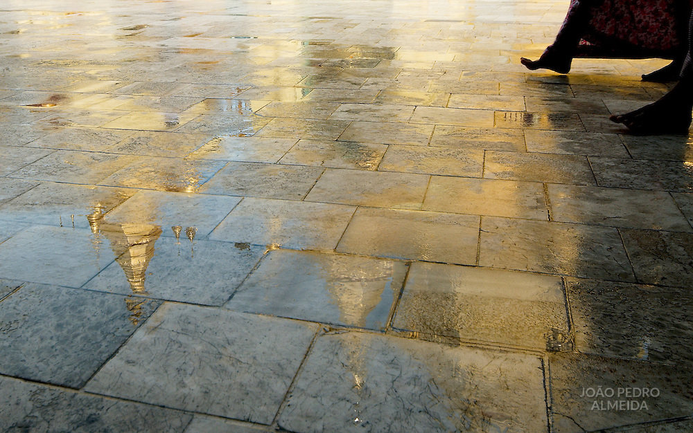 Burmesse walking at Sule pagoda after a rainfall