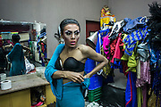 A dragqueen prepares for a perfomance in a gay bar in busy touristic street of Kuta, Bali, Indonesia. The bar had the dragqueen show everynight.