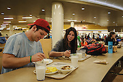 Ohio University student Martin Ernsberger eats dinner with  his girlfriend Kelsey Bieri at Nelson Dining hall at dinner on Sunday, December 2, 2012.  (© Brien Vincent)