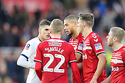 Tottenham Hotspur midfielder Erik Lamela (11) and Middlesbrough midfielder George Saville (22) have an exchange of views with Middlesbrough forward Rudy Gestede (14) and Middlesbrough defender Dael Fry (6) acting as peace makers during the The FA Cup match between Middlesbrough and Tottenham Hotspur at the Riverside Stadium, Middlesbrough, England on 5 January 2020.
