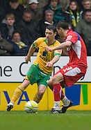 Norwich City - Saturday May 8 2010: of Norwich City's Wes Hoolahan battles the ball past Carlisle's Evan Horwood during match at Carrow Road, Norwich. (Pic by Rob Colman Focus Images)