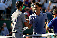 Indian Wells, CA - Roger Federer of Switzerland and Novak Djokovic of Serbia meet at net after match point during the final match at the BNP Paribas Open.