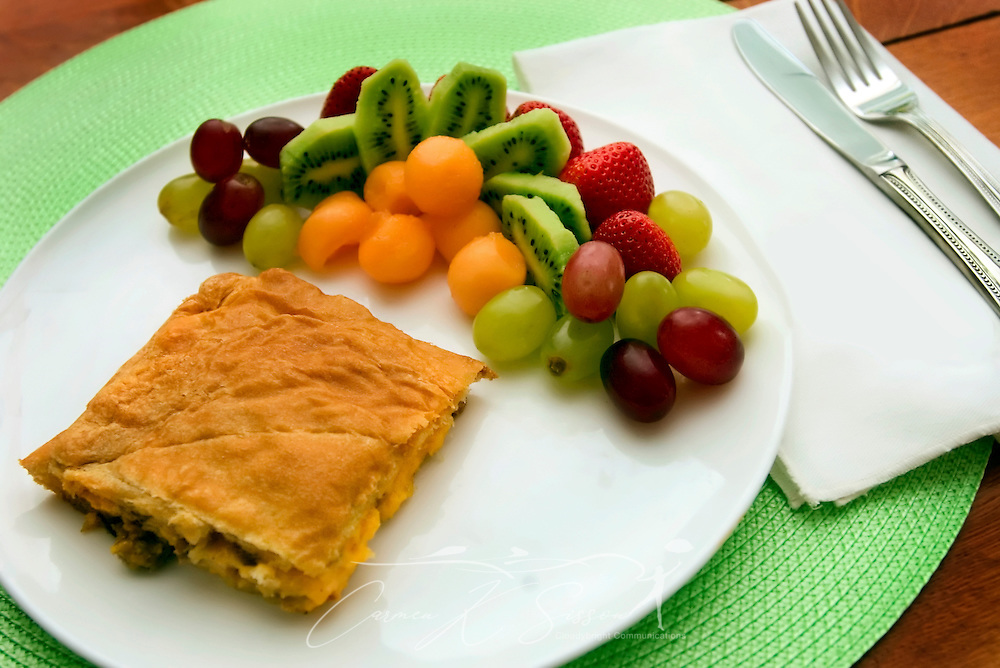 An egg and sausage breakfast pastry is served with kiwi, grapes and other fruit at the Jackie O' House in Columbus, Miss. The upscale bed and breakfast was built in 1907 and is listed in the National Historic Register. (Photo by Carmen K. Sisson/Cloudybright)
