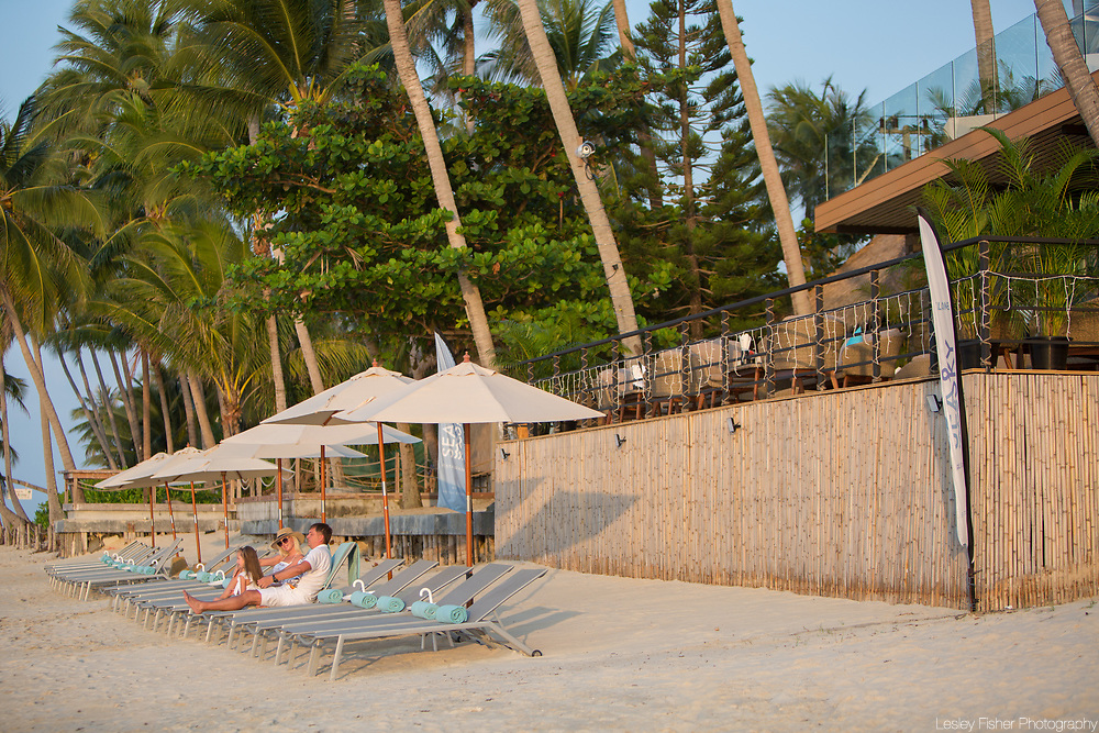 Family time at Sea and Sky beach front restaurant located on Ban Tai beach, Koh Samui, Thailand