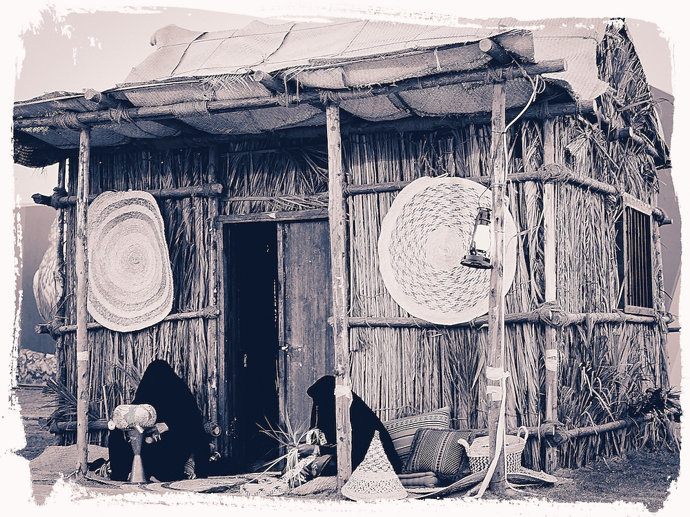 A Native Hut made out of wood sticks, wooden palm tree leaves, straw,