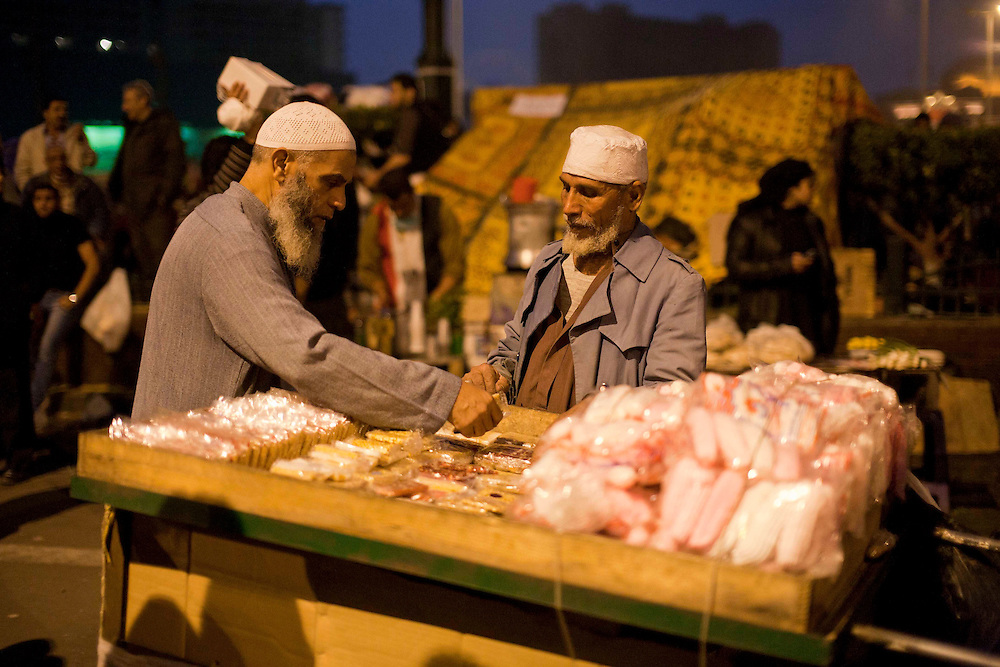 a man sells sweets to the crowd Tahrir Square on November 22, 2011 photo by: Maya Levin