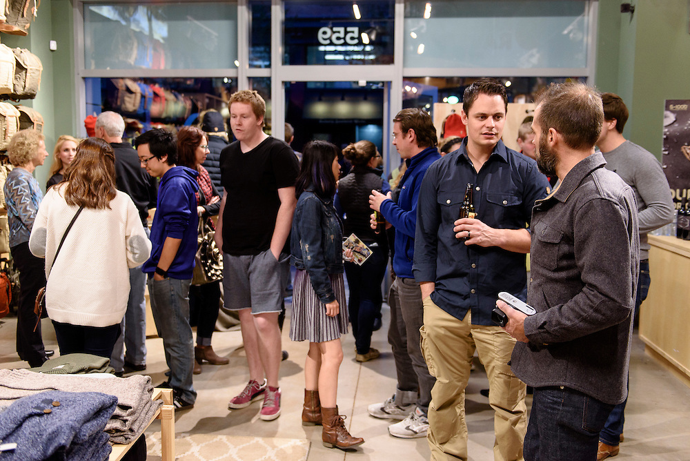 Guests mingle and look at clothing apparel and outdoor-outfitter gear during a grand opening event for Fjällräven Madison, a Swedish-heritage brand store in downtown Madison, Wis., on Oct. 22, 2015. Pictured second from right is Steve Stout, Fjällräven Vice President of Retail. (Photo by Jeff Miller - www.jeffmillerphotography.com)