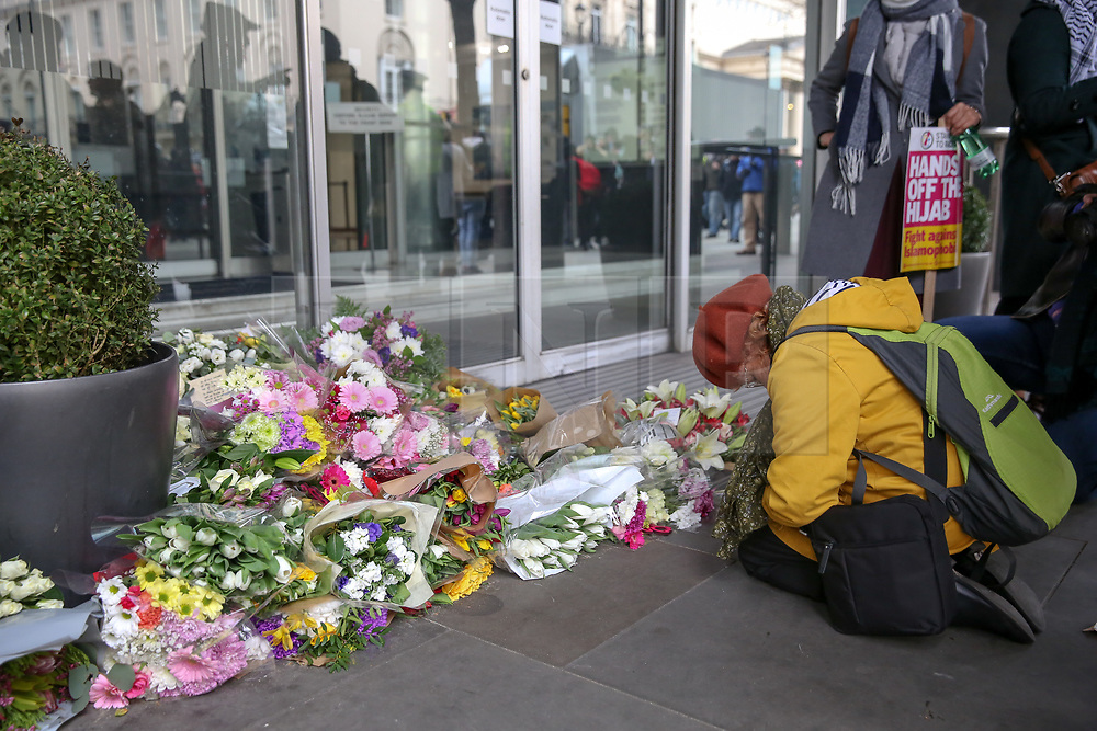 © Licensed to London News Pictures. 16/03/2019. London, UK. A woman prays at High Commission of New Zealand in London for the victim of the Christchurch shooting, where a gunman killed 49 worshippers at the Al Noor Masjid and Linwood Masjid mosques in Christchurch, New Zealand on 15 March. The 28-year-old Australian suspect, Brenton Tarrant, appeared in court on 16 March and was charged with murder. Photo credit: Dinendra Haria/LNP