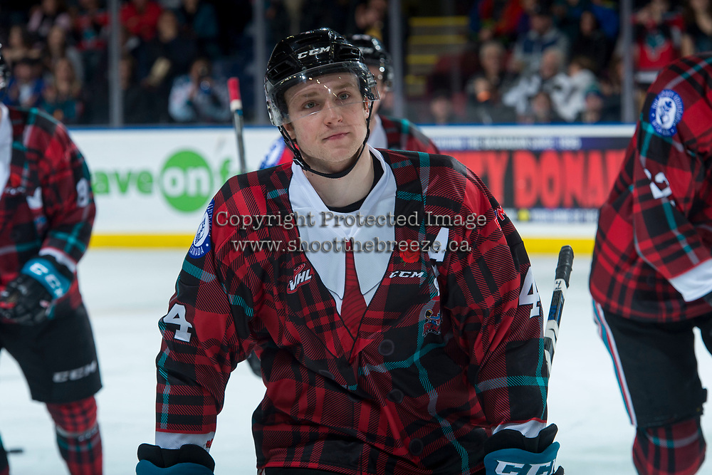 KELOWNA, CANADA - MARCH 10:  Gordie Ballhorn #4 of the Kelowna Rockets skates to the bench to celebrate a goal against the Kamloops Blazers on March 10, 2018 at Prospera Place in Kelowna, British Columbia, Canada.  (Photo by Marissa Baecker/Shoot the Breeze)  *** Local Caption ***