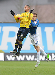 Tom Lockyer of Bristol Rovers battles for the ball with Kemar Roofe of Oxford United - Mandatory byline: Alex James/JMP - 17/01/2016 - FOOTBALL - The Kassam Stadium - Oxford, England - Oxford United v Bristol Rovers - Sky Bet League Two