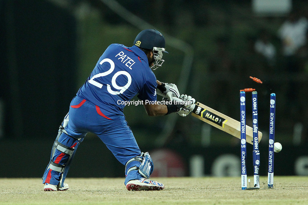 Samit Patel of England is bowled by Lasith Malinga during the ICC World Twenty20 Super Eights match between England and Sri Lanka held at the  Pallekele Stadium in Kandy, Sri Lanka on the 1st October 2012<br /> <br /> Photo by Ron Gaunt/SPORTZPICS