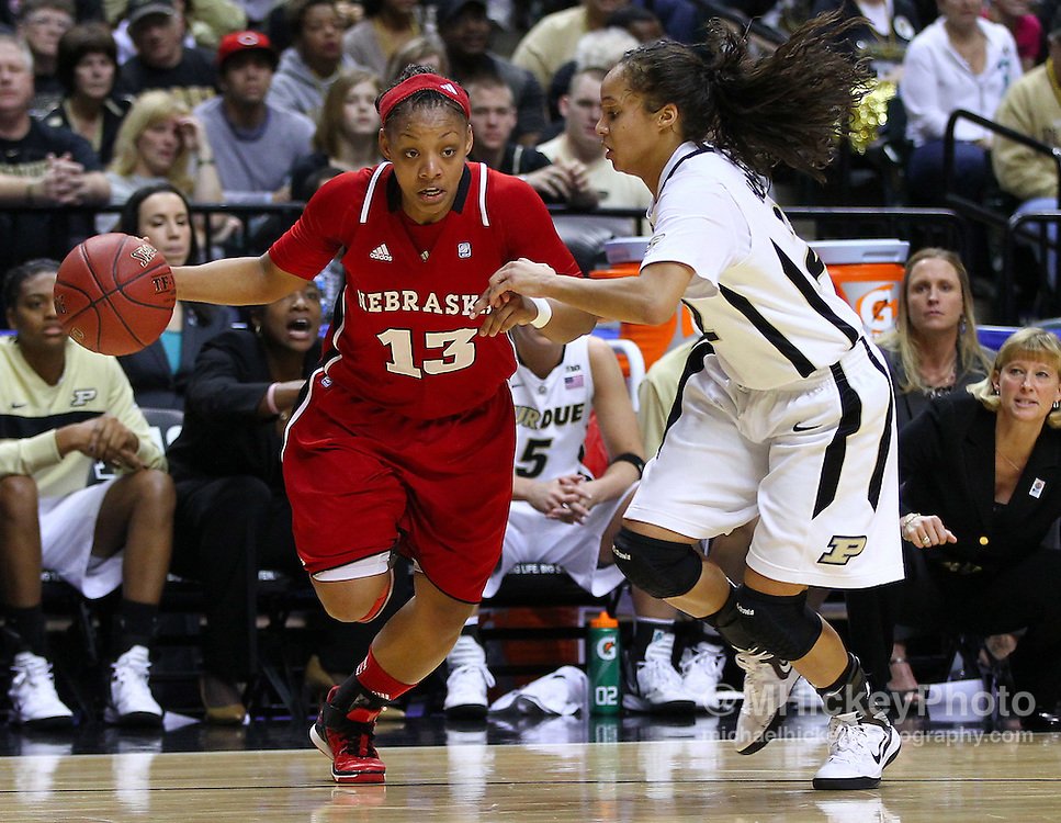 March 04, 2012; Indianapolis, IN, USA; Nebraska Cornhuskers guard Brandi Jeffery (13) dribbles against Purdue Boilermakers guard KK Houser (22) during the finals of the 2012 Big Ten Tournament at Bankers Life Fieldhouse. Purdue defeated Nebraska 74-70 in 2OT. Mandatory credit: Michael Hickey-US PRESSWIRE