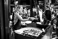 Woman sells food in Borough Market, London