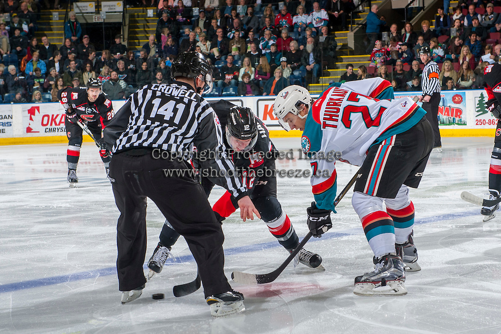 KELOWNA, CANADA - FEBRUARY 18: Linesman Kevin Crowell drops the puck between Jansen Harkins #12 of the Prince George Cougars and Calvin Thurkauf #27 of the Kelowna Rockets on February 18, 2017 at Prospera Place in Kelowna, British Columbia, Canada.  (Photo by Marissa Baecker/Shoot the Breeze)  *** Local Caption ***