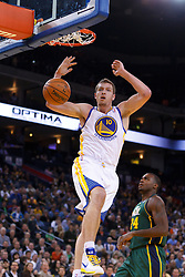 Feb 2, 2012; Oakland, CA, USA; Golden State Warriors power forward David Lee (10) dunks against the Utah Jazz during the first quarter at Oracle Arena. Mandatory Credit: Jason O. Watson-US PRESSWIRE