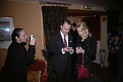 Roxanne Lowitt, David Furnish and Daphne guinness, Valentino couture show, Ecole Nationale Superiore des Beaux -Arts, rue Bonaparte. After party at the Ritz. 23 January  2006.  ONE TIME USE ONLY - DO NOT ARCHIVE  © Copyright Photograph by Dafydd Jones 66 Stockwell Park Rd. London SW9 0DA Tel 020 7733 0108 www.dafjones.com