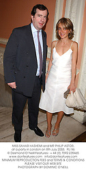 MISS SAHAR HASHEMI and MR PHILIP ASTOR, at a party in London on 8th July 2003.PLI 96