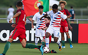 Portugal defender Francisco Silva (5) slide tackles into Team USA defender Justin Reynolds (16) during a CONCACAF boys under-15 championship soccer game, Saturday, August 10, 2019, in Bradenton, Fla. Portugal defeated Team USA 3-0 and advanced to the finals against Slovenia. (Kim Hukari/Image of Sport)