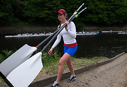 © Licensed to London News Pictures.13/06/15<br /> Durham, England<br /> <br /> A girl carries her oars along the slipway after racing during the 182nd Durham Regatta rowing event held on the River Wear. The origins of the regatta date back  to commemorations marking victory at the Battle of Waterloo in 1815. This is the second oldest event of this type in the country and attracts over 2000 competitors from across the country.<br /> <br /> Photo credit : Ian Forsyth/LNP