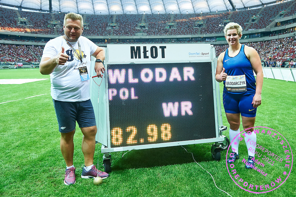 Warsaw, Poland - 2016 August 28: Poland's Anita Wlodarczyk (R) with her coach Krzysztof Kaliszewski pose with a world record in the women's hammer throw competition with the result 82.98m during athletics meeting Kamila Skolimowska Memorial 2016 at PGE National Stadium  August 28, 2016 w Warsaw, Poland.<br />
