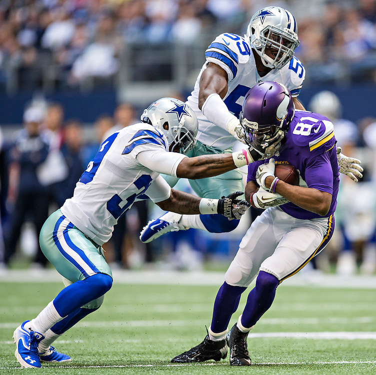 ARLINGTON, TX - NOVEMBER 3:  Jerome Simpson #81 of the Minnesota Vikings is grabbed by the face mask by Brandon Carr #39 of the Dallas Cowboys at  AT&T Stadium on November 3, 2013 in Arlington, Texas.  The Cowboys defeated the Vikings 27-23.  (Photo by Wesley Hitt/Getty Images) *** Local Caption *** Jerome Simpson; Brandon Carr