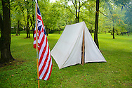 8/18/12 11:43:54 AM - Warwick, PA. -- A flag and tent rest in camp during a revolutionary war reenactment at the Moland House August 18, 2012 in Warwick, Pennsylvania. -- (Photo by William Thomas Cain/Cain Images)..