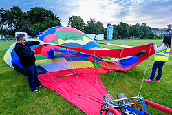 Strathaven Scotland UK 27th August 2016 - The Strathaven Balloon Festival is an annual event and the only one of its kind in Scotland held in 2016 from 26th - 28th August. The first flights of the festival took place at dawn on Saturday 27th August <br /> <br /> Preparing a balloon for flight.<br /> <br /> (c) Andrew Wilson | Edinburgh Elite media