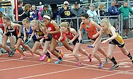 A group of girls lean in at the start of the 300 hurdles during the Central Bucks West Relays at Central Bucks West High School Saturday April 23, 2016 in Doylestown, Pennsylvania. (Photo by William Thomas Cain)