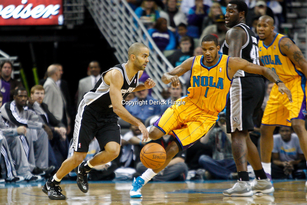 January 22, 2011; New Orleans, LA, USA; San Antonio Spurs point guard Tony Parker (9) drives past New Orleans Hornets small forward Trevor Ariza (1) during the first quarter at the New Orleans Arena.   Mandatory Credit: Derick E. Hingle