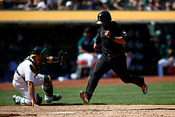 OAKLAND, CA - AUGUST 25: Donovan Solano #7 of the San Francisco Giants scores a run against the Oakland Athletics during the seventh inning at the RingCentral Coliseum on August 25, 2019 in Oakland, California. The San Francisco Giants defeated the Oakland Athletics 5-4. Teams are wearing special color schemed uniforms with players choosing nicknames to display for Players' Weekend. (Photo by Jason O. Watson/Getty Images) *** Local Caption *** Donovan Solano