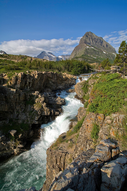Many Glacier area, Glacier National Park:  The Swiftcurrent River cascades out of Swiftcurrent Lake, Mt. Grinnell in the background.