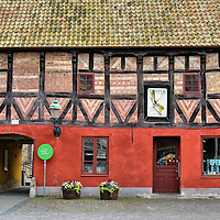 Hedmanska Gården Half-timbered Façade in Malmö, Sweden <br /> On the south side of the Lilla Torg square in Malmö, Sweden is this half-timbered building called Hedmanska Gården. One look at it and you know it has a fascinating history. It was constructed during the 16th century as the first building on the Hedmanska Farm. Neighboring buildings were added during the 17th and 18th centuries. It is now the home of the Form/ Design Center showcasing innovative architectural and industrial designs.