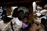 Children take shelter in caves as an Antanov bomber passes overhead. Thousands of people have fled to caves to live after repeated bombing attacked by Sudan government forces on civilians areas.