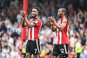 Brentford Midfielder Florian Jozefzoon (7) and Brentford Midfielder Kamohelo Mokotjo (12) applaud the crowd after the EFL Sky Bet Championship match between Brentford and Queens Park Rangers at Griffin Park, London, England on 21 April 2018. Picture by Stephen Wright.