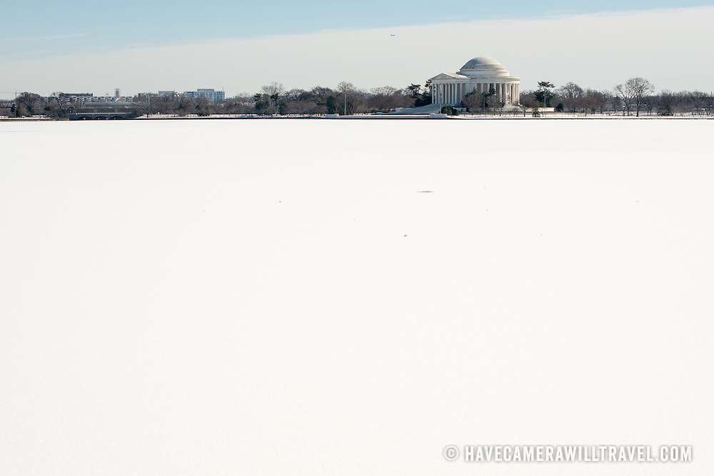 The Jefferson Memorial stands out on the opposite bank of an ice and snow-covered Tidal Basin in Washington DC. Winter temperatures have been lower than average for the region.