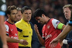 LONDON, ENGLAND - Oct 01: Arsenal's midfielder Mikel Arteta from Spain sustains an injury during the UEFA Champions League match between Arsenal from England and Napoli from Italy played at The Emirates Stadium, on October 01, 2013 in London, England. (Photo by Mitchell Gunn/ESPA)