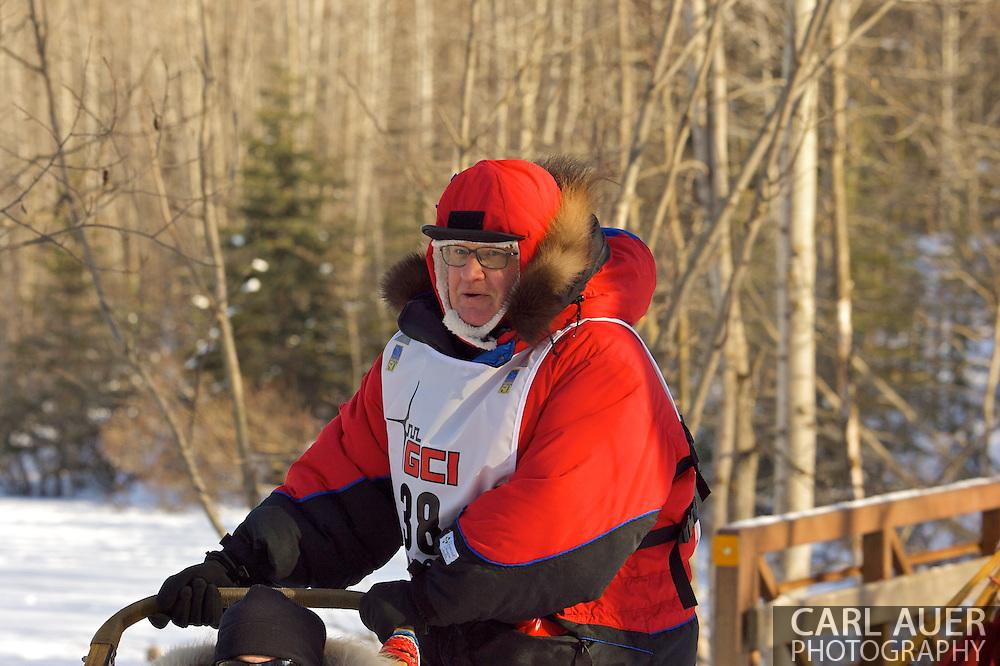March 7th, 2009:  Anchorage, Alaska:  Gerald Sousa of Talkeetna, Alaska heads across a foot bridge next to Behm Lake during the 2009 Iditarod.