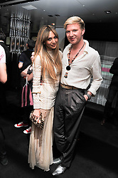 ZARA MARTIN and HENRY CONWAY at a party to launch the Gucci designed Fiat 500 customized by Gucci Creative Director Frida Giannini in collaboration with FIAT's Centro Stile, held at Fiat, 105 Wigmore Street, London on 27th June 2011.