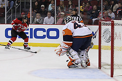 Apr 10, 2010; Newark, NJ, USA; New Jersey Devils left wing Dean McAmmond (11) scores a goal on New York Islanders goalie Martin Biron (43) during the first period at the Prudential Center.
