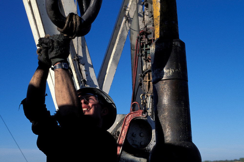 Canada, Alberta, (MR) Steve Breum works on Cactus Drilling oil rig on prairie