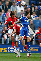 Photo: Steve Bond.<br /> Leicester City v Barnsley. Coca Cola Championship. 27/10/2007. Matty Fryatt (front) is outjumped by Dennis Souza (rear)