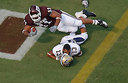 Texas A&M running back Jorvorskie Lane dives  over Montana State cornerback Kory Austin as lane scores in the second quarter. Texas A&M won the game 38-7 at Kyle Field in College Station, TX.