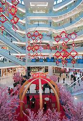 Interior view of modern large shopping mall in Wangfujing Beijing