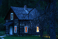 Bull River Guard Station at twilight, one of the original ranger stations in the Kootenai National Forest now used as a rental cabin. Bull River Valley, northwest Montana.