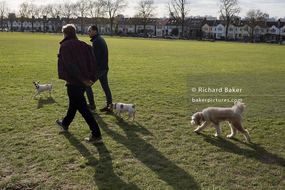 As the second week of the Coronavirus lockdown continues and a week before Easter when Prime Minister Boris Johnson reminds Britons to stay locally and not to travel to beauty spots, the UK death toll rises to 2,921, with 1m cases of Covid-19 worldwide in 181 countries. Londoners and their dogs enjoy sunshine and spring temperatures in Brockwell Park in Herne Hill, 3rd April 2020, in south London, England.