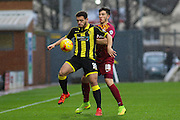 Burton Albion's Mason Bennett and Bradford City defender Christopher Routis challenge for the ball during the Sky Bet League 1 match between Burton Albion and Bradford City at the Pirelli Stadium, Burton upon Trent, England on 6 February 2016. Photo by Aaron Lupton.