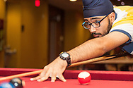 A student plays pool at The Sett Rec at Union South during the annual Sunburst Festival in 2014.
